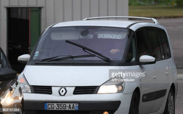 A picture taken on June 29 2017 shows gendarmes in a convoy leaving the gendarmerie in SaintEtienneLesRemiremont eastern France as they drive...