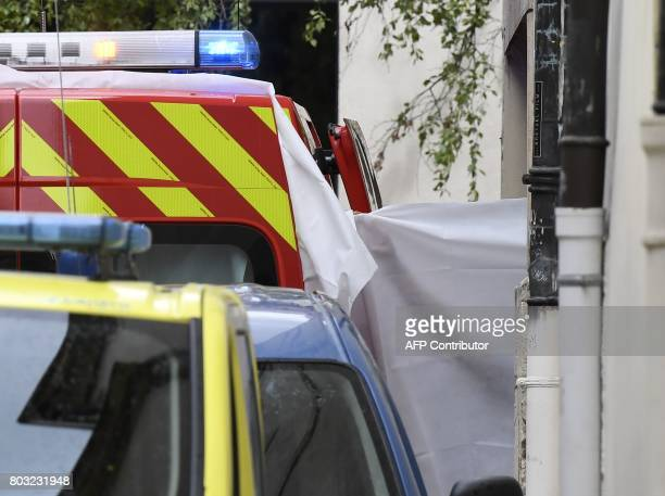 A picture taken on June 29 shows a white sheet set on a medic vehicle outside the courthouse of Dijon where Murielle Bolle is being heard for...
