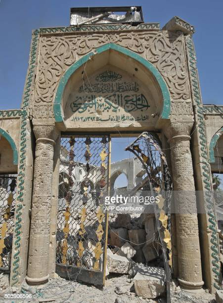 A picture taken on June 30 shows the destroyed gate of the AlNuri Mosque in the Old City of Mosul as Iraqi government forces continue their offensive...