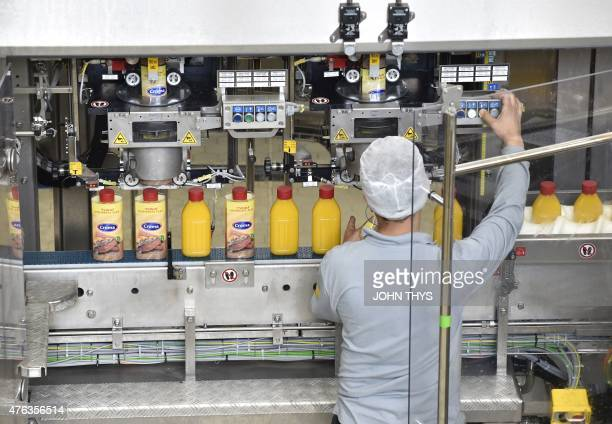 RABAT A picture taken on June 5 2015 shows a worker checking bottles of margarine on the packaging line at the Unilever's factory in Rotterdam...