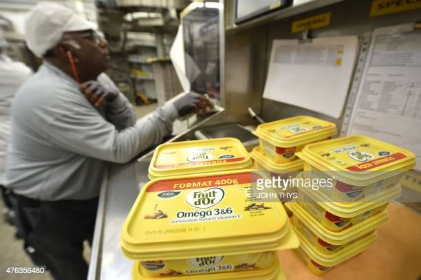 RABAT A picture taken on June 5 2015 shows a worker checking margarines at the Unilever's factory in Rotterdam Unilever is a multinational company in...