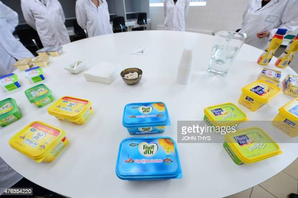RABAT A picture taken on June 5 2015 shows workers testing margarines at the Unilever's headquarters in Rotterdam Unilever is a multinational company...