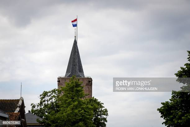A picture taken on June 5 2017 shows a Dutch national flag at halfmast after a 14yearold girl was found in a ditch on the edge of the De Kronkels...