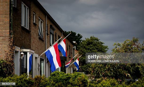 A picture taken on June 5 2017 shows Dutch national flags at halfmast after a 14yearold girl was found in a ditch on the edge of the De Kronkels...