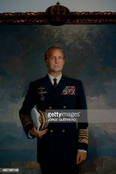 A picture taken on June 6 2014 shows a portrait of Spain's King Juan Carlos during the exhibition 'Los Reyes de Espana en Malaga De Isabel la...