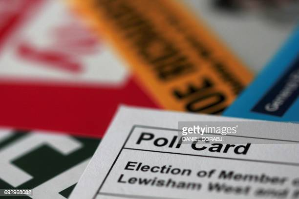 A picture taken on June 6 in London shows a poll card and election leaflets from various parties displayed ahead of the United Kingdom's general...
