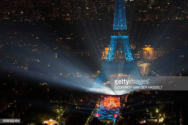 TOPSHOT A picture taken on June 9 2016 from the Montparnasse tower shows the opening concert of the Paris fan zone on the Champs de Mars by the...
