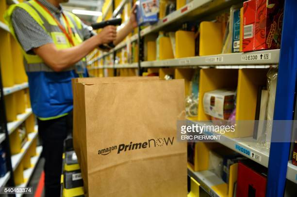 A picture taken on June 9 2016 shows Amazon warehouse in Paris part of the new service 'Prime Now' Amazon will launch on June 16 2016 'Prime Now' its...