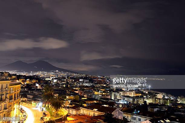A picture taken on March 07 2014 shows the Naples' gulffrom the Posillipo hill at night AFP PHOTO / GABRIEL BOUYS