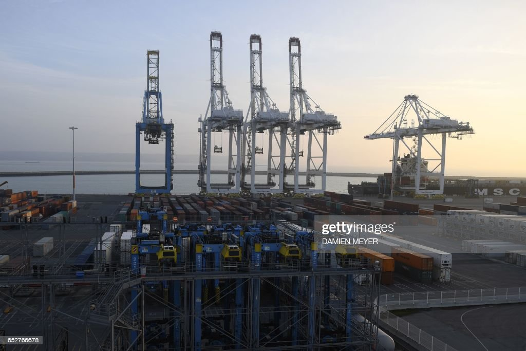 A picture taken on March 10, 2017 shows container loaders at Le Havre commercial port, northwestern France. /