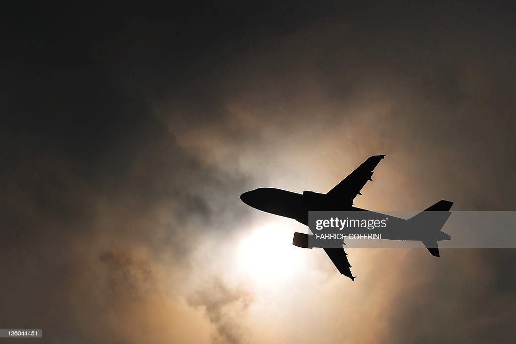 A picture taken on March 11, 2010 shows a passenger plane shortly after takeoff at the Geneva international airport. Europe's top court threw out December 21, 2011 a US-led challenge to new charges for carbon emissions across EU airspace, opening up fears of a possible trade war which could also draw in China. North American airlines had challenged a European Union decision to include as of January 1 all carriers in a carbon trading system targeting heavy polluting industries as part of the EU's efforts against climate change.
