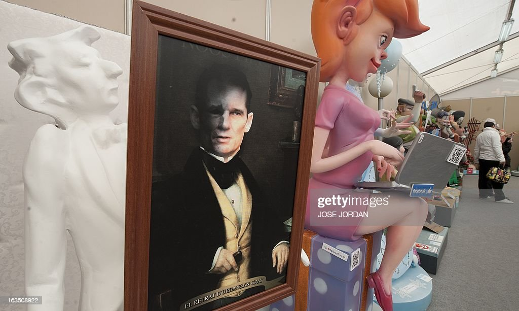 A picture taken on March 11, 2013 shows a Falla, a gigantic sculpted structure of cardboard and wood which humorously portrays relevant current events and personalities, caricaturing Spanish King's son-in-law Inaki Urdangarin, during an exhibition before preparations for the Fallas Festival, in Valencia. The Fallas will be burned in the streets of Valencia on March 19, 2013, as a tribute to St. Joseph, patron saint of the carpenters' guild.