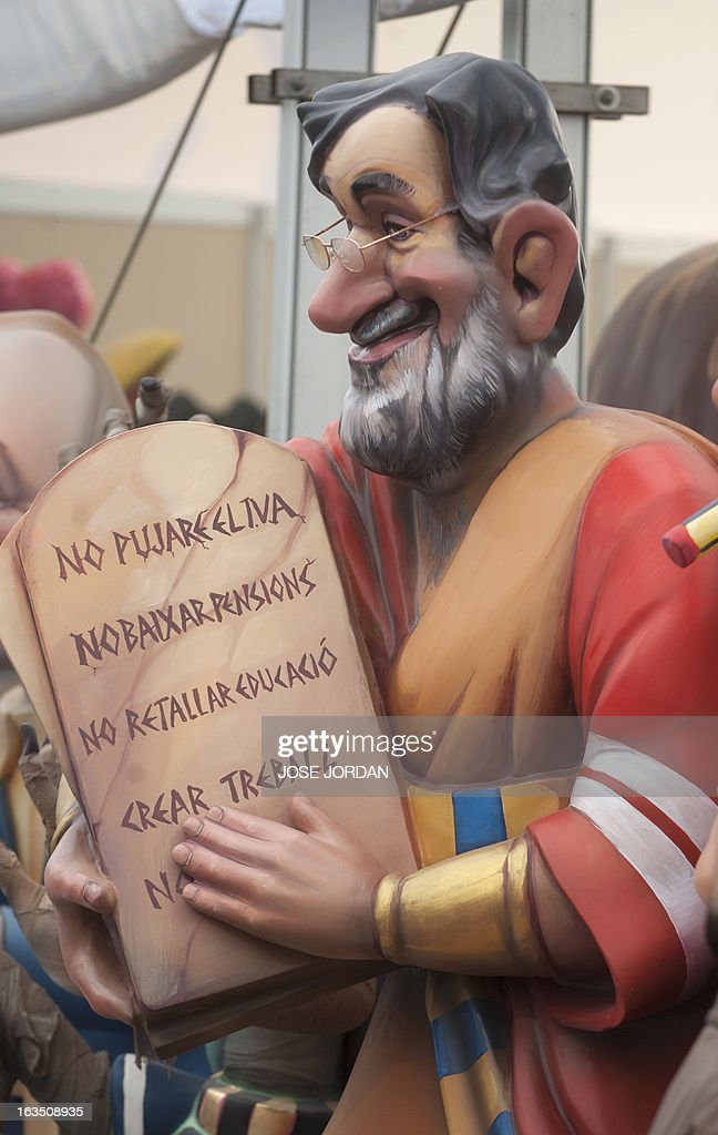 A picture taken on March 11, 2013 shows a Falla, a gigantic sculpted structure of cardboard and wood which humorously portrays relevant current events and personalities, caricaturing Spain's Prime Minister Mariano Rajoy, during an exhibition before preparations for the Fallas Festival, in Valencia. The Fallas will be burned in the streets of Valencia on March 19, 2013, as a tribute to St. Joseph, patron saint of the carpenters' guild.