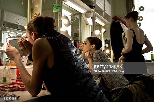 A picture taken on March 12 shows the participants of 'Russky Ballet' all Russian Ballet Competition applying makeup backstage as they prepare to...