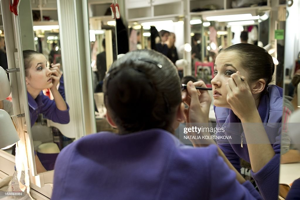 A picture taken on March 12, 2013, shows the participants of 'Russky Ballet' (Russian Ballet), all Russian Ballet Competition, applying makeup backstage as they prepare to compete at Bolshoi Theatre in Moscow. 26 last year students of 10 ballet schools from Moscow, St.Petersburg, Perm, Kazan and other cities from all over Russia competed yesterday at the stage of at the legendary theatre, the Russian media reported.