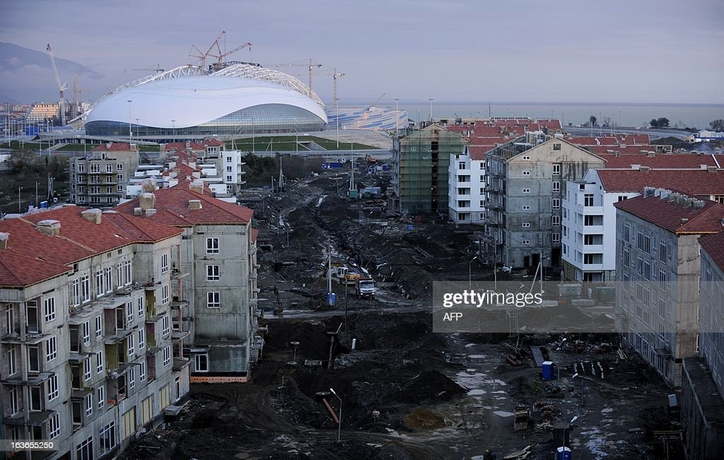 A picture taken on March 13, 2013 shows a view of the Bolshoi Ice Palace and Olympic village construction sites at the Olympic Park in the Russian Black Sea resort of Sochi. State overspending on the 2014 Sochi Winter Olympics amounts to more than half a billion dollars while the government has failed to provide a lasting legacy for sporting venues, according to an official audit report.