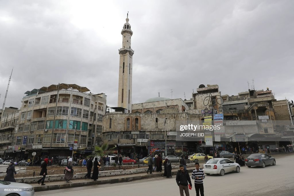A picture taken on March 13, 2017 shows a general view of a street in the city of Hama in central Syria. /