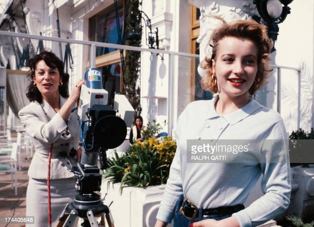 A file picture taken on March 14 1980 shows French actress Bernadette Lafont shooting with a camera her daughter French actress Pauline Lafont during...