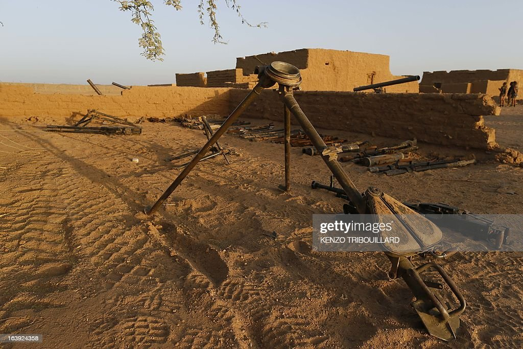 A picture taken on March 14, 2013 at the Tessalit camp in northern Mali shows arms and munitions recovered by French forces in the mountains in northern Mali. French Defense Minister Jean-Yves Le Drian said on March 17 that a 24-year-old soldier, Corporal Alexandre Van Dooren of the 1st Marine Infantry Regiment (RIMA), was killed on March 16 and three of his comrades wounded when their vehicle was struck by a roadside bomb blast in the Ifoghas mountains. TRIBOUILLARD