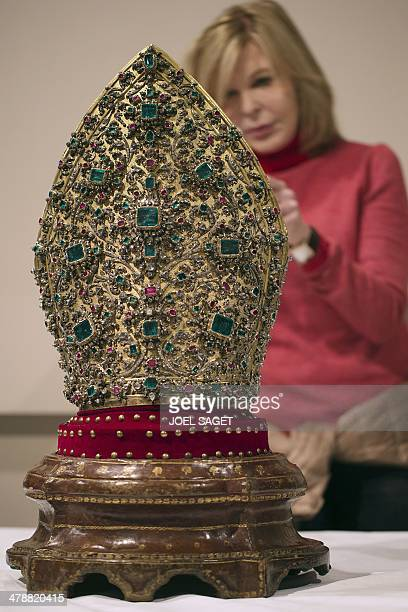 A picture taken on March 14 2014 at the Maillol museum in Paris shows the mitre of San Gennaro dating from 1713 The exhibition 'The treasures of...