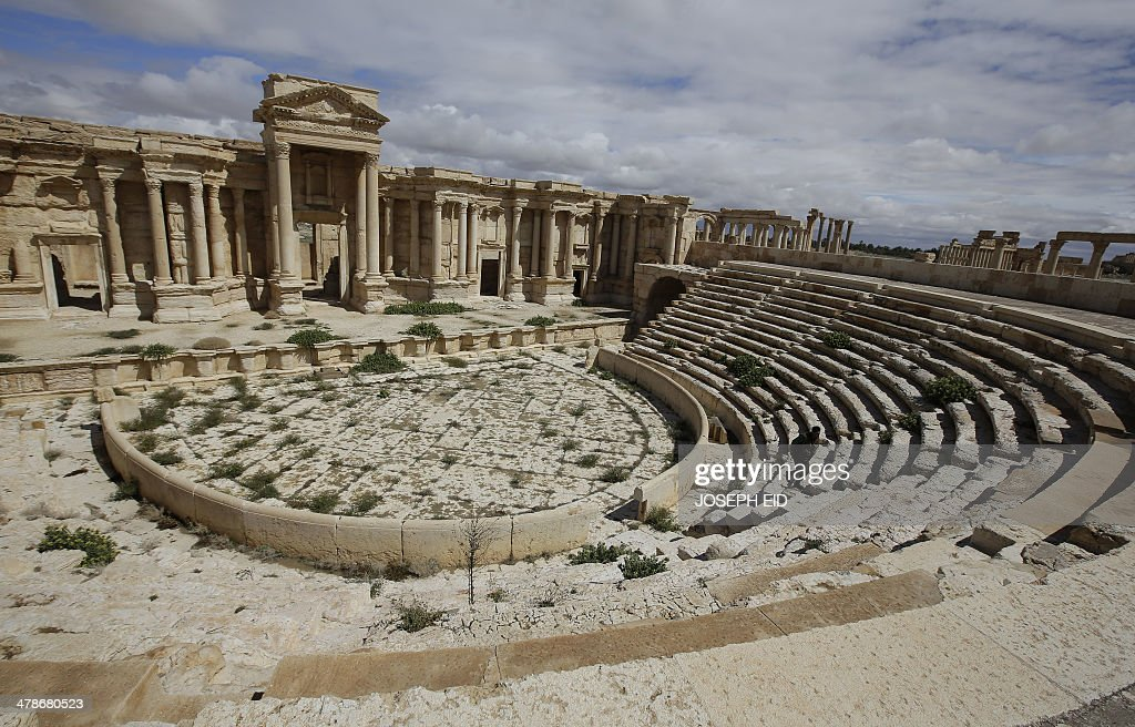 A picture taken on March 14 2014 shows a partial view of the theatre at the ancient oasis city of Palmyra 215 kilometres northeast of Damascus From...