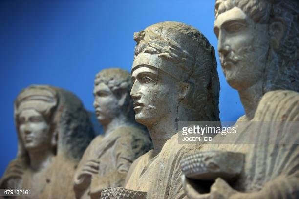 A picture taken on March 14 2014 shows a sculpture depicting a princess from the ancient Syrian oasis city of Palmyra 215 kilometres northeast of...