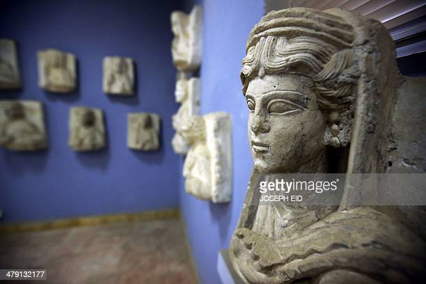 A picture taken on March 14 2014 shows a sculpture found in the ancient Syrian oasis city of Palmyra 215 kilometres northeast of Damascus and now...