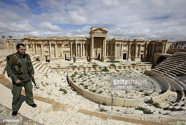 A picture taken on March 14 2014 shows a Syrian policeman patrolling the ancient oasis city of Palmyra 215 kilometres northeast of Damascus From the...