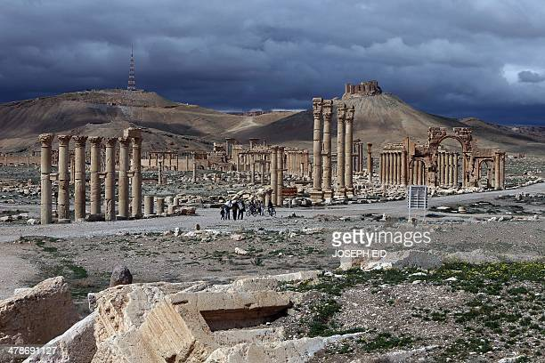A picture taken on March 14 2014 shows the citadel of the ancient oasis city of Palmyra 215 kilometres northeast of Damascus over looking the city...