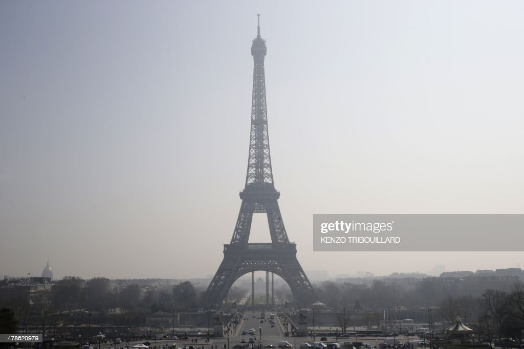 A picture taken on March 14, 2014 shows the Eiffel tower in central Paris through a haze of pollution. More than 30 departments in France are hit by maximum level pollution alerts since the day before, prompting Ecology Minister to say air quality was 'an emergency and a priority for the government.'