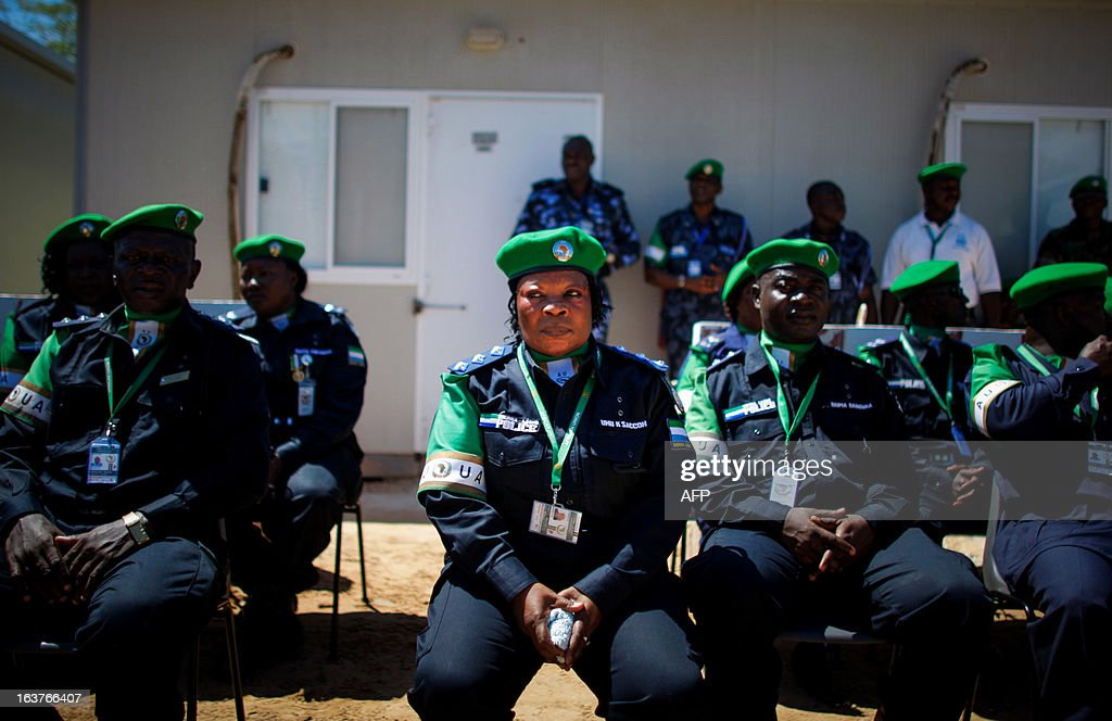 CREDIT 'AFP PHOTO / AU-UN IST / STUART PRICE' - NO MARKETING NO ADVERTISING CAMPAIGNS - DISTRIBUTED AS A SERVICE TO CLIENTS A picture taken on March 15, 2013 and released by the African Union-United Nations Information Support Team, shows officers from the Sierra Leonean Contingent serving with the African Union Mission in Somalia (AMISOM) Individual Police Officers (IPO) sitting during a medal parade at the AU Mission's headquarters in the Somali capital Mogadishu. 38 officers each received a 6-month Medal of Service today marking the mid-way point of their 1-year deployment to Somalia where they have been central in assisting the reforming restructuring, monitoring and mentoring of the Somali Police Force (SPF) as it begins rebuilding after two decades of conflict and instability in the Horn of Africa nation.