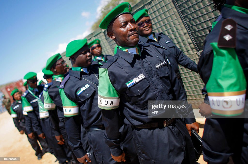A picture taken on March 15, 2013 and released by the African Union-United Nations Information Support Team, shows officers from the Sierra Leonean Contingent serving with the African Union Mission in Somalia (AMISOM) Individual Police Officers (IPO) walking during a medal parade at the AU Mission's headquarters in the Somali capital Mogadishu. 38 officers each received a 6-month Medal of Service today marking the mid-way point of their 1-year deployment to Somalia where they have been central in assisting the reforming restructuring, monitoring and mentoring of the Somali Police Force (SPF) as it begins rebuilding after two decades of conflict and instability in the Horn of Africa nation. AFP PHOTO / AU-UN IST / STUART PRICE