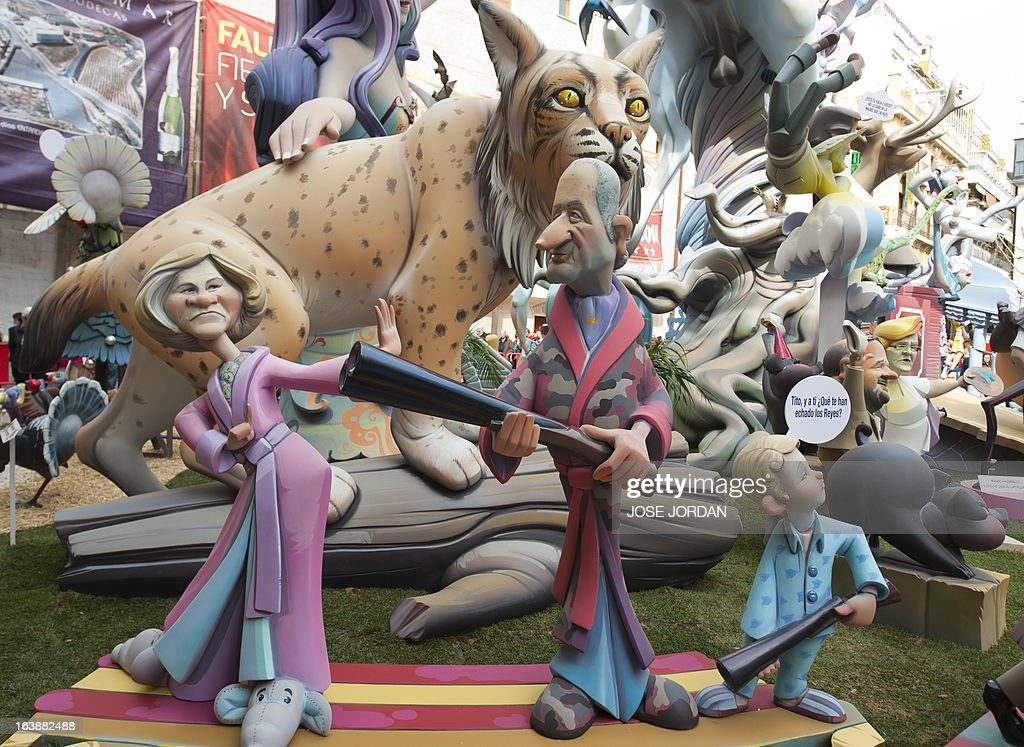 A picture taken on March 17, 2013 shows a Falla, a gigantic sculpted satirical structure made of cardboard, caricaturing Spain's King Juan Carlos with his wife Queen Sofia during an exhibition for the Fallas Festival, in Valencia. The Fallas will be burned in the streets of Valencia on March 19, 2013, as a tribute to St Joseph, patron saint of the carpenters' guild. AFP PHOTO / JOSE JORDAN