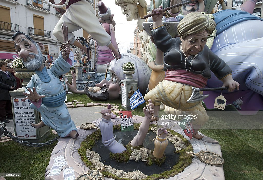 A picture taken on March 17, 2013 shows a Falla, a gigantic sculpted satirical structure made of cardboard, caricaturing German Chancellor Angela Merkel and Spanish Prime Minister Mariano Rajoy during an exhibition for the Fallas Festival, in Valencia. The Fallas will be burned in the streets of Valencia on March 19, 2013, as a tribute to St Joseph, patron saint of the carpenters' guild.