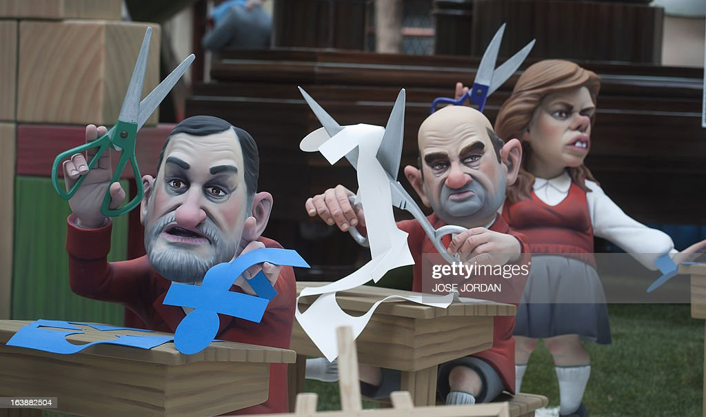 A picture taken on March 17, 2013 shows a Falla, a gigantic sculpted satirical structure made of cardboard, caricaturing Spanish Prime Minister Mariano Rajoy, Spanish Finance Minister Cristobal Montoro and Spain's deputy prime minister Soraya Saenz de Santamaria during an exhibition for the Fallas Festival, in Valencia. The Fallas will be burned in the streets of Valencia on March 19, 2013, as a tribute to St Joseph, patron saint of the carpenters' guild.