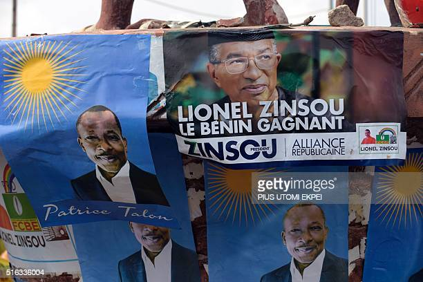 A picture taken on March 17 2016 shows campaign posters of current Benin Prime Minister and candidate of the ruling party Cowrie Forces for an...