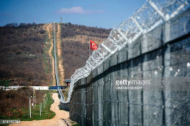 A picture taken on March 17 shows a Turkish flag flying over the barbedwire fence of the BulgarianTurkish border near the Bulgarian village of Lesovo...