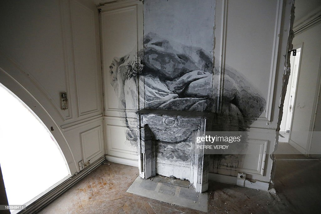 A picture taken on March 18, 2013 shows an artwork during street art performances at the 'Bains-Douches' nightclub in Paris. Famous Parisian nightclub the 'Bains-Douches' was turned into a temporary artistic residence exhibiting street art works before revamp in early April to be turned into a hotel lounge by 2014.