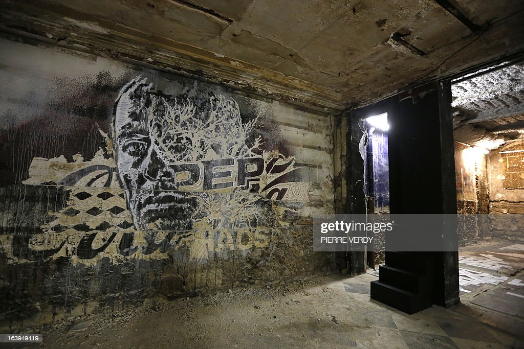 A picture taken on March 18, 2013 shows artworks during street art performances at the 'Bains-Douches' nightclub in Paris. Famous Parisian nightclub the 'Bains-Douches' was turned into a temporary artistic residence exhibiting street art works before revamp in early April to be turned into a hotel lounge by 2014. AFP PHOTO / PIERRE VERDY CAPTION