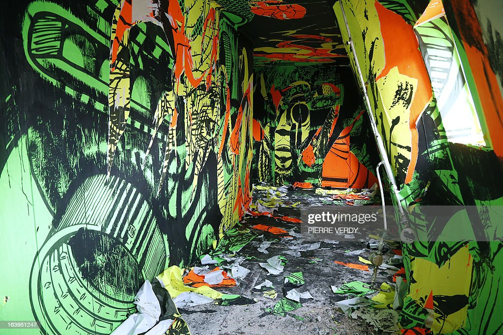 A picture taken on March 18, 2013 shows artworks during street art performances at the 'Bains-Douches' nightclub in Paris. Famous Parisian nightclub the 'Bains-Douches' was turned into a temporary artistic residence exhibiting street art works before revamp in early April to be turned into a hotel lounge by 2014.