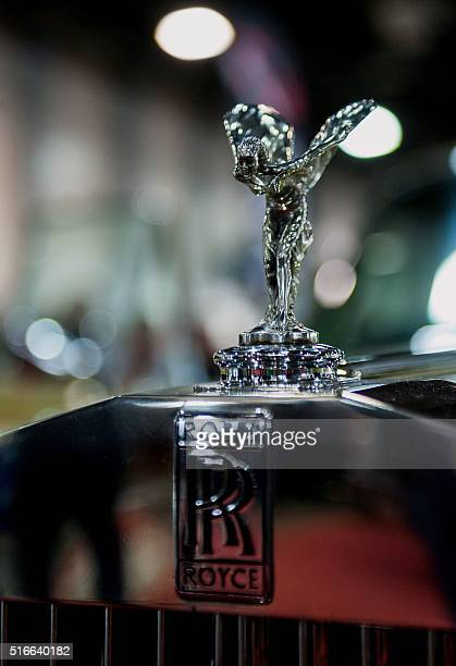 A picture taken on March 18 2016 shows the symbol of a Rolls Royce car during a threeday auto motor and tuning show at the Hungexpo Budapest Fair...