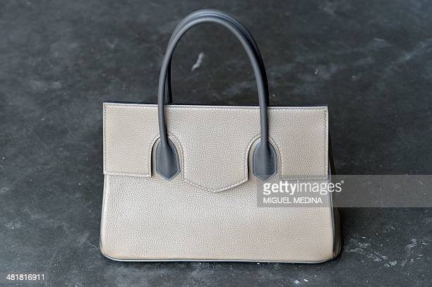 A picture taken on March 19 2014 shows a handbag made of calf leather displayed at the workshop of French designer of luxury leather goods Serge...
