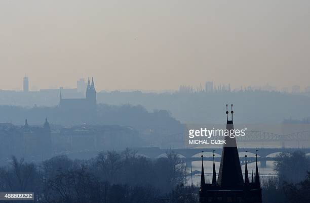 Picture taken on March 19 early morning from Prague Castle shows a city landscape with towers of Vysehrad Castle AFP PHOTO / MICHAL CIZEK