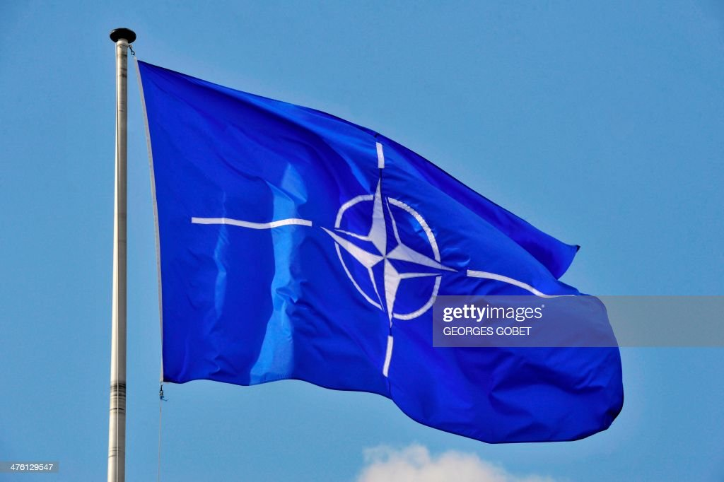 A picture taken on March 2 2014 shows the NATO flag in the wind at the NATO headquarters in Brussels AFP PHOTO / GEORGES GOBET
