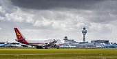 A picture taken on March 2 2016 shows a Yangtze River Express plane next to the control tower at Schiphol Airport in Amsterdam The Dutch Safety Board...