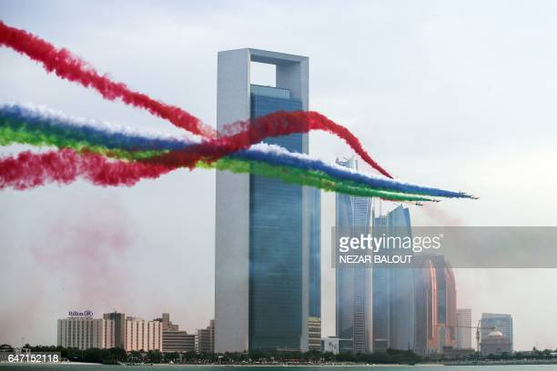 A picture taken on March 2 2017 in Abu Dhabi shows Emirati planes performing in an airshow as part of the 'Union Fortress Live Military...