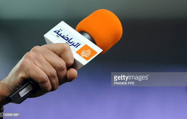 A picture taken on March 21 2012 shows a microphone with the logo of Qatarbased broadcaster Al Jazeera before the French Cup football match Paris vs...