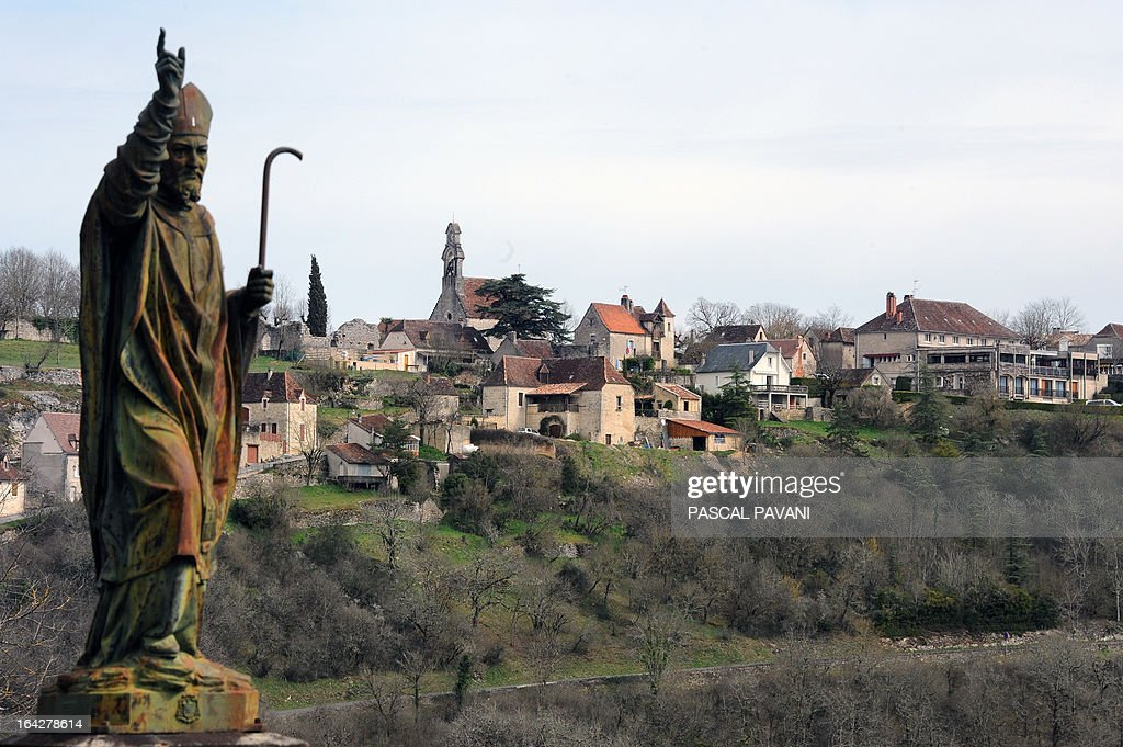 A picture taken on March 21, 2013 shows partially the village Le Belvedere, with Saint Martial statue at left, near Rocamadour, a Unesco World Heritage site since 1979, in southwestern France, which will celebrate from March 25, a jubilee for the thousand years of the pilgrimage to the Black Madonna and the 100th anniversary of its basilica. AFP PHOTO/PASCAL PAVANI