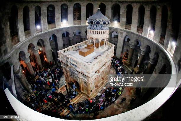 TOPSHOT A picture taken on March 21 2017 at the Church of the Holy Sepulchre in the Old City of Jerusalem shows the renovated Edicule of the Tomb of...