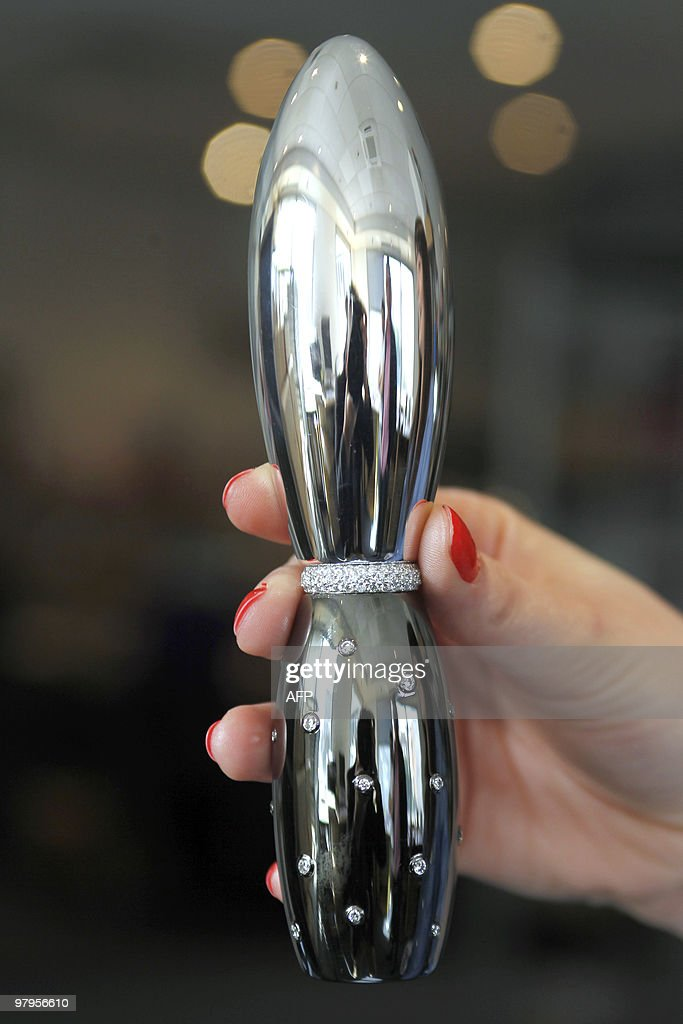 A picture taken on March 22, 2010 in Paris shows a woman showing a 18-carat diamond ring mounted in a sex toy, sold by a Paris jeweller for 40,000-euros (55,000-dollars). The luxury sex toy 'was designed for rich people who want to declare their love in a special way,' said Jean-Francois Tokars, a manager at Maison Victor on Paris' posh place Vendome.
